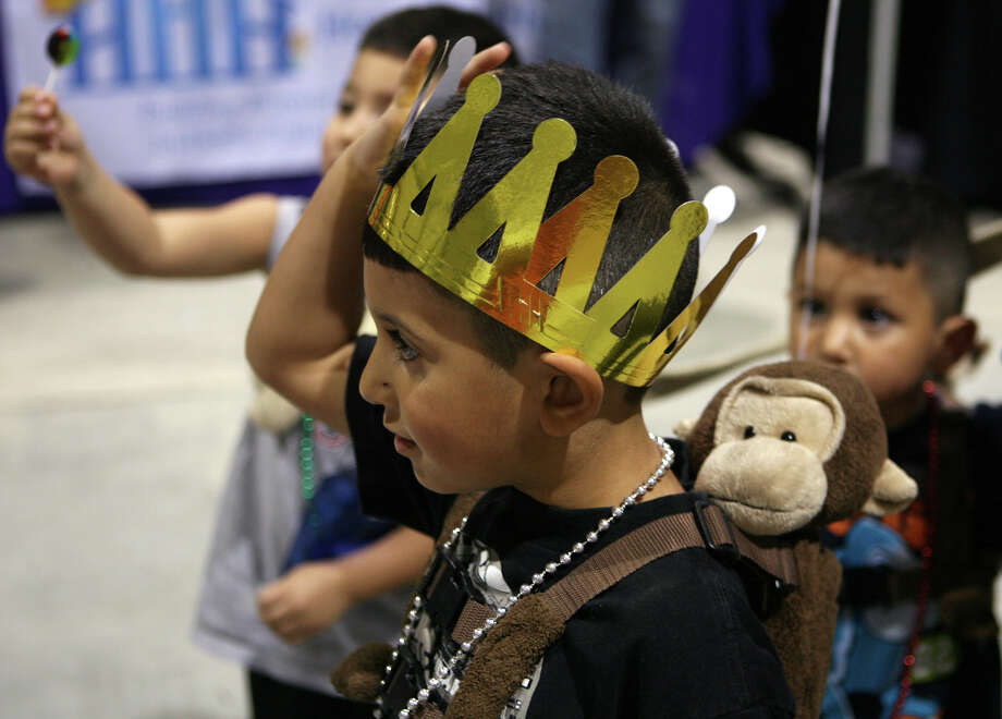 Jordan Cervantes, 6, walks around the San Antonio Back 2 School Expo Aug. 10, 2013 with a crown he got at the Smile Kings booth at the Freeman Coliseum Expo Hall. Over 50 vendors participated in the event that offered a variety of  items for back to school, including toothbrushes, back packs, crayon, haircuts and shots. Photo: Cynthia Esparza, For San Antonio Express-News / For San Antonio Express-News