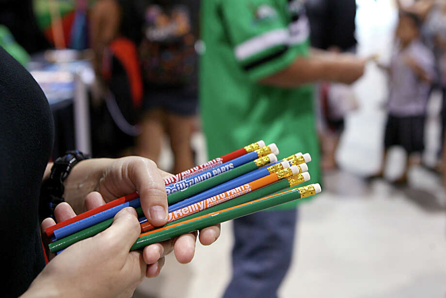 Stacey Crawford hands out O'Reilly Auto Parts pencils Aug. 10, 2013 during the San Antonio Back 2 School Expo at the Freeman Coliseum Expo Hall. Over 50 vendors participated in the event that offered a variety of  items for back to school, including toothbrushes, back packs, crayon, haircuts and shots. Photo: Cynthia Esparza, For San Antonio Express-News / For San Antonio Express-News