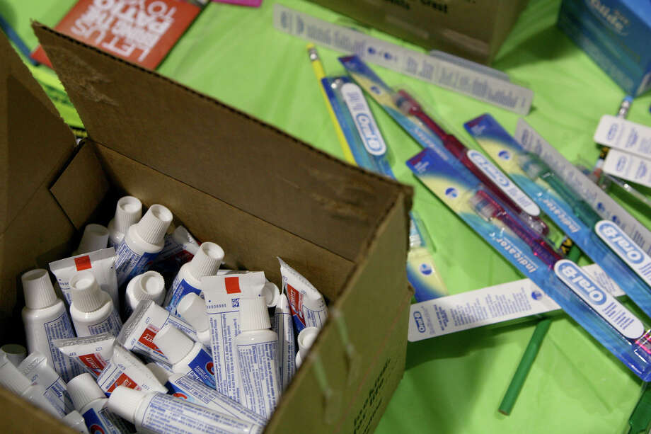 Toothpaste and toothbrushes could be won at the Cute Smiles 4 Kids booth during the San Antonio Back 2 School Expo Aug. 10, 2013 at the Freeman Coliseum Expo Hall. Over 50 vendors participated in the event that offered a variety of  items for back to school, including toothbrushes, back packs, crayons, haircuts and shots. Photo: Cynthia Esparza, For San Antonio Express-News / For San Antonio Express-News