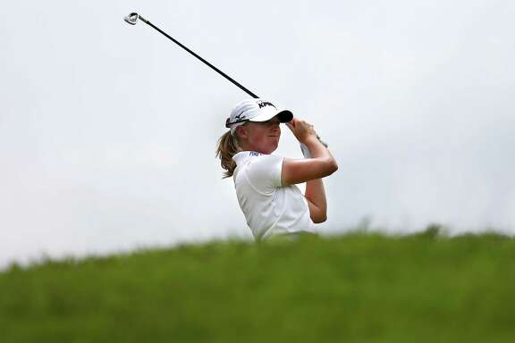 Stacy Lewis has gone from wearing a back brace in her school years in The Woodlands to a No. 2 world ranking.