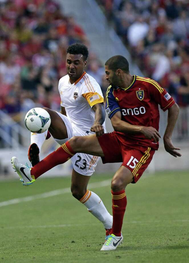 Houston Dynamo's Giles Barnes (23) and Real Salt Lake's Alvaro Saborio (15) battle for a ball in the first half of an MLS soccer game, Saturday, Aug. 10, 2013, in Sandy, Utah. (AP Photo/Rick Bowmer) Photo: Rick Bowmer, Associated Press / AP