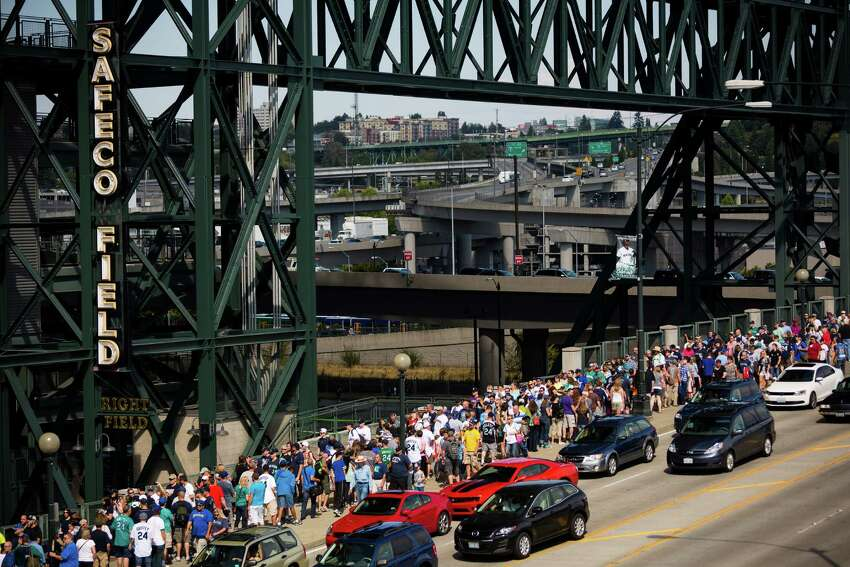 A sold-out crowd of over 46,000 lines up to attend a pregame ceremony for the induction of retired Mariners player Ken Griffey Jr. into the Mariners Hall of Fame.