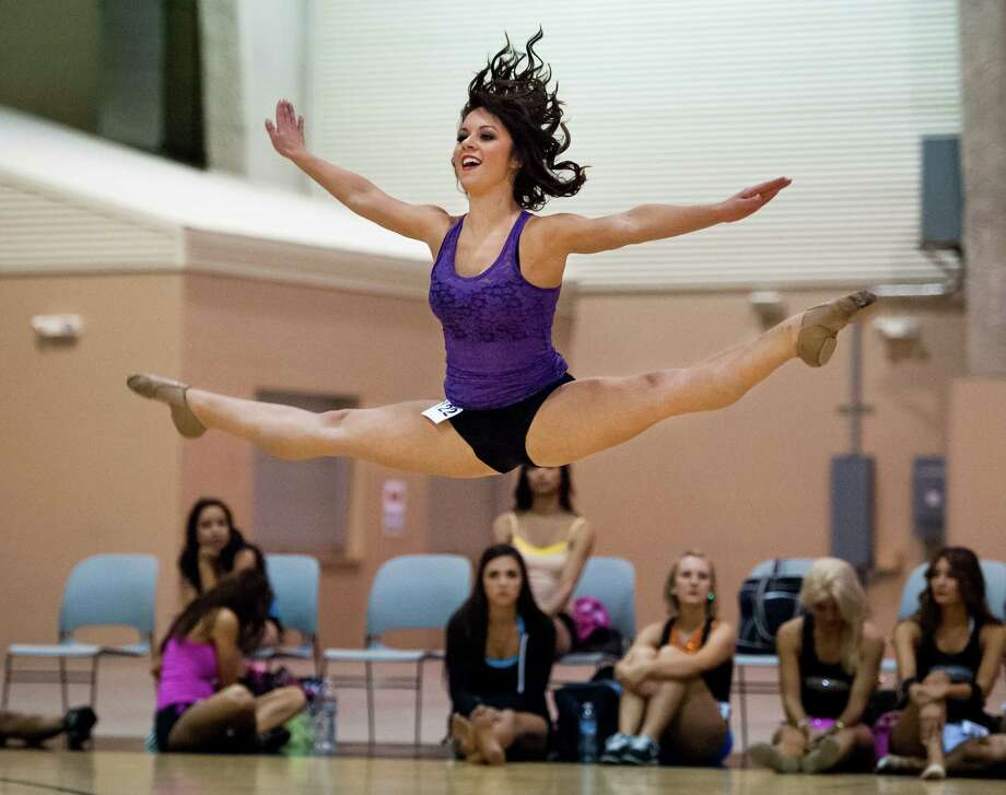 Kelsey Wildman performs a dance routine during the Silver Dancers auditions. Wildman made the cut Saturday. The next step is the interview this week. Photo: Darren Abate / For The San Antonio Express-News