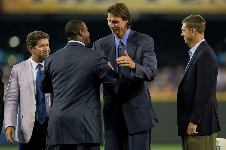 Ken Griffey Jr., center left, greets former teammate Randy Johnson, while fellow former teammates Edgar Martinez,. left, and Dan Wilson, right, look on. Photo: JORDAN STEAD, SEATTLEPI.COM / SEATTLEPI.COM