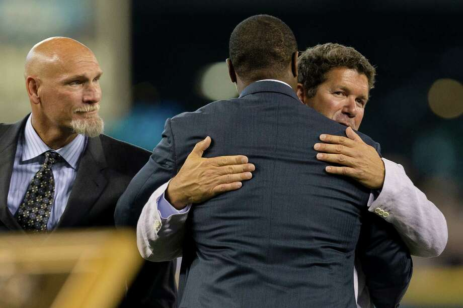 Ken Griffey Jr., center, hugs Edgar Martinez while fellow former teammate Jay Buhner looks on. Photo: JORDAN STEAD, SEATTLEPI.COM / SEATTLEPI.COM