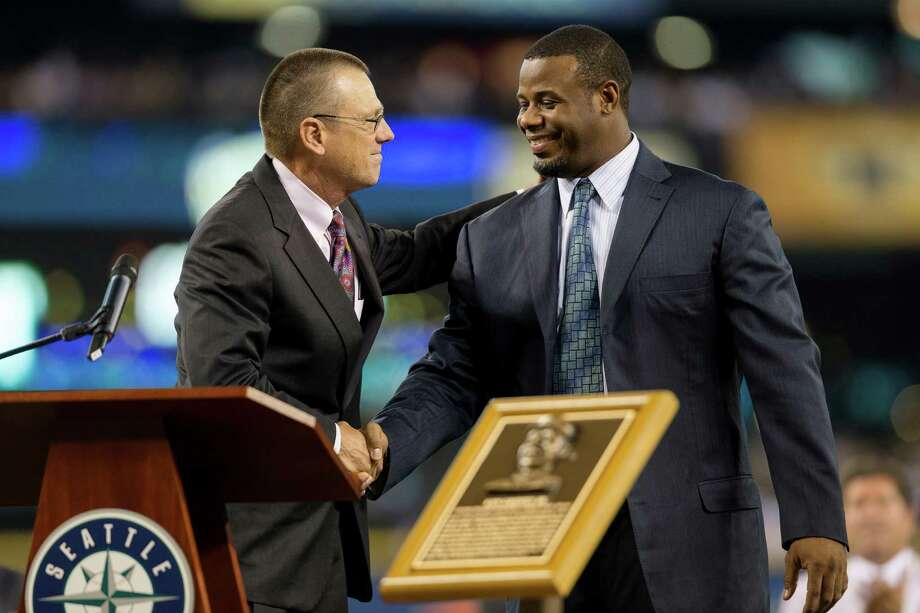 Ken Griffey Jr. shakes the hand of Barry McConnell, president and CEO of Make-A-Wish Foundation, left. Photo: JORDAN STEAD, SEATTLEPI.COM / SEATTLEPI.COM