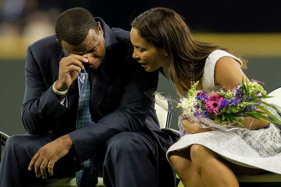 An emotional Ken Griffey Jr., left, is comforted by his wife, Melissa Griffey, right, after seeing a recorded video of his oldest son broadcast on the big screen. Photo: JORDAN STEAD, SEATTLEPI.COM / SEATTLEPI.COM