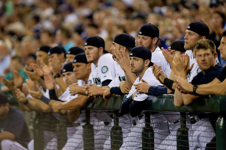 Current Mariners pay homage by wearing backwards caps. Photo: JORDAN STEAD, SEATTLEPI.COM / SEATTLEPI.COM