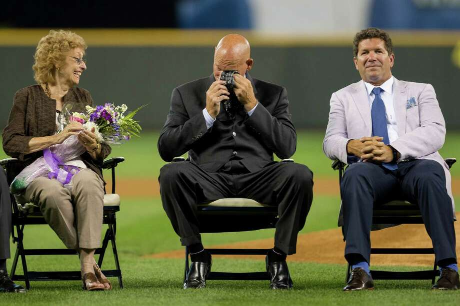 Jay Buhner, center, breaks down in tears as Marilyn Niehaus, left, wife of late Mariners broadcaster Dave Niehaus, and Edgar Martinez, right, look on. Photo: JORDAN STEAD, SEATTLEPI.COM / SEATTLEPI.COM