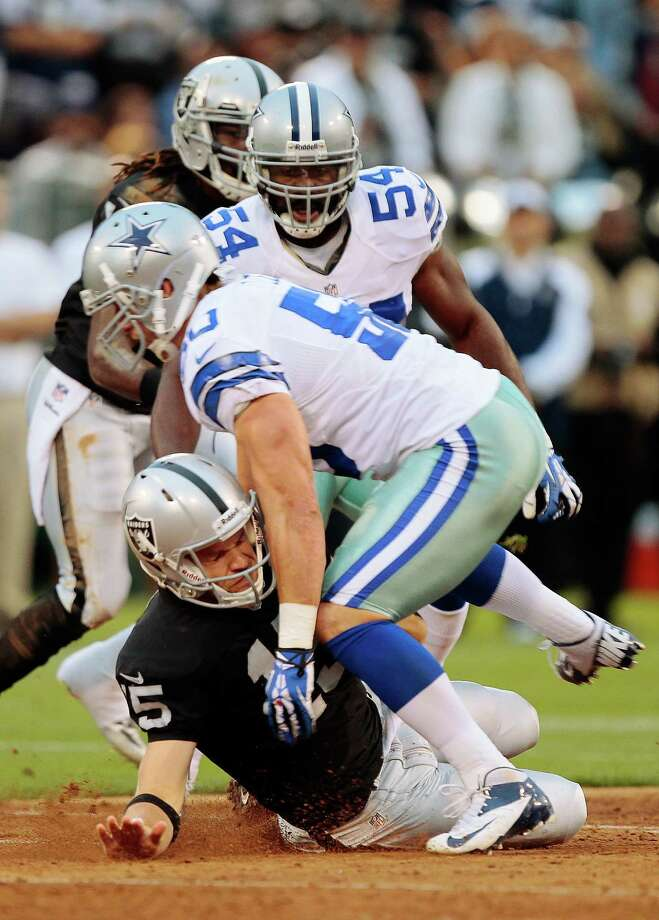 Cowboys linebacker Sean Lee made an immediate, big contribution in his first game back by sacking Raiders QB Matt Flynn to cause a fumble Friday night. Photo: Brian Bahr / Getty Images