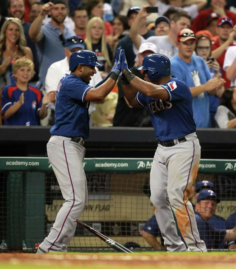Elvis Andrus #1 of the Texas Rangers, left, celebrates his two-run home run with Adrian Beltre #29 during the seventh inning against the Houston Astros on August 10, 2013 at Minute Maid Park in Houston. Photo: Eric Christian Smith, Getty Images / 2013 Getty Images
