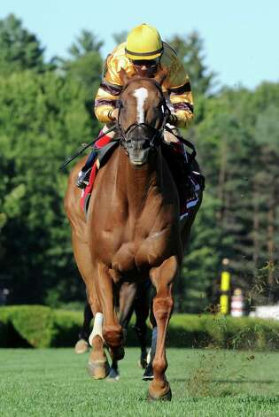 Wise Dan with jockey John Velazquez, left  went around the field in the 29th running of The Fourstardave Aug. 9, 2013, at Saratoga Race Course in Saratoga Springs, N.Y.   Second place went to King Kressa with jockey Irad Ortiz Jr., right.      (Skip Dickstein/Times Union) Photo: SKIP DICKSTEIN