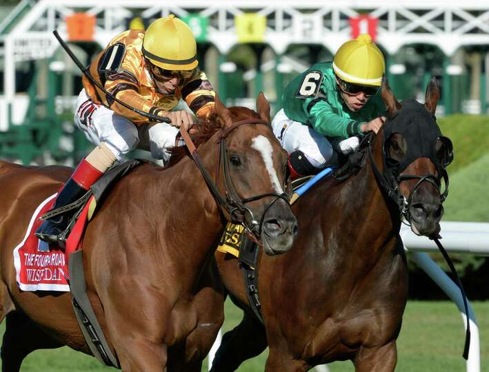 Wise Dan with jockey John Velazquez, left  went around the field in the 29th running of The Fourstar
