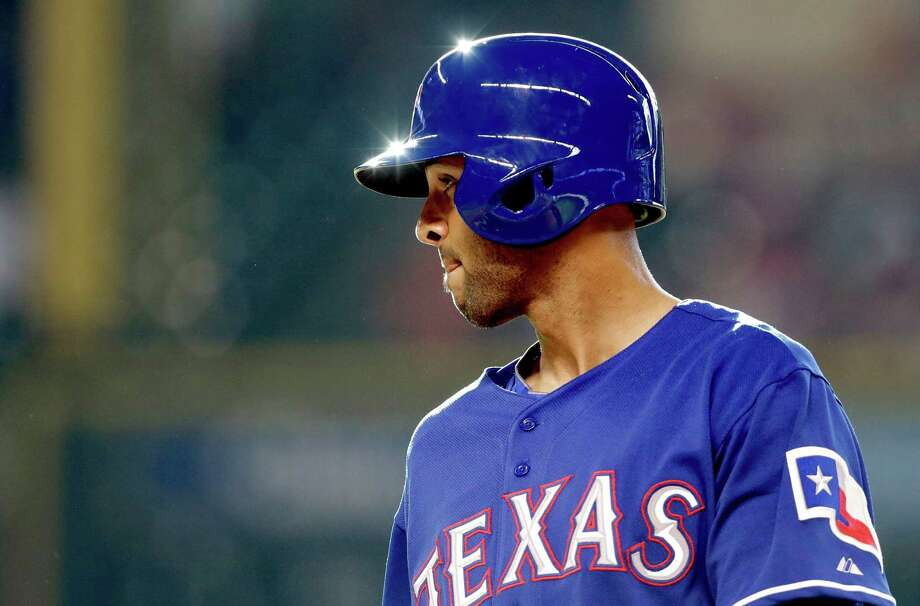 In his first game as a Texas Rangers' Alex Rios takes a walk against the Houston Astros in the second inning of a baseball game, Saturday, Aug. 10, 2013, in Houston. (AP Photo/Pat Sullivan) Photo: Pat Sullivan, Associated Press / AP
