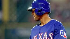 In his first game as a Texas Rangers' Alex Rios takes a walk against the Houston Astros in the second inning of a baseball game, Saturday, Aug. 10, 2013, in Houston. (AP Photo/Pat Sullivan)