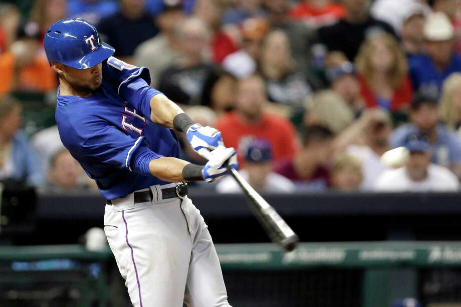 Texas Rangers' Alex Rios hits an RBI triple against the Houston Astros in the eighth inning of a baseball game, Saturday, Aug. 10, 2013, in Houston. (AP Photo/Pat Sullivan) Photo: Pat Sullivan, Associated Press / AP