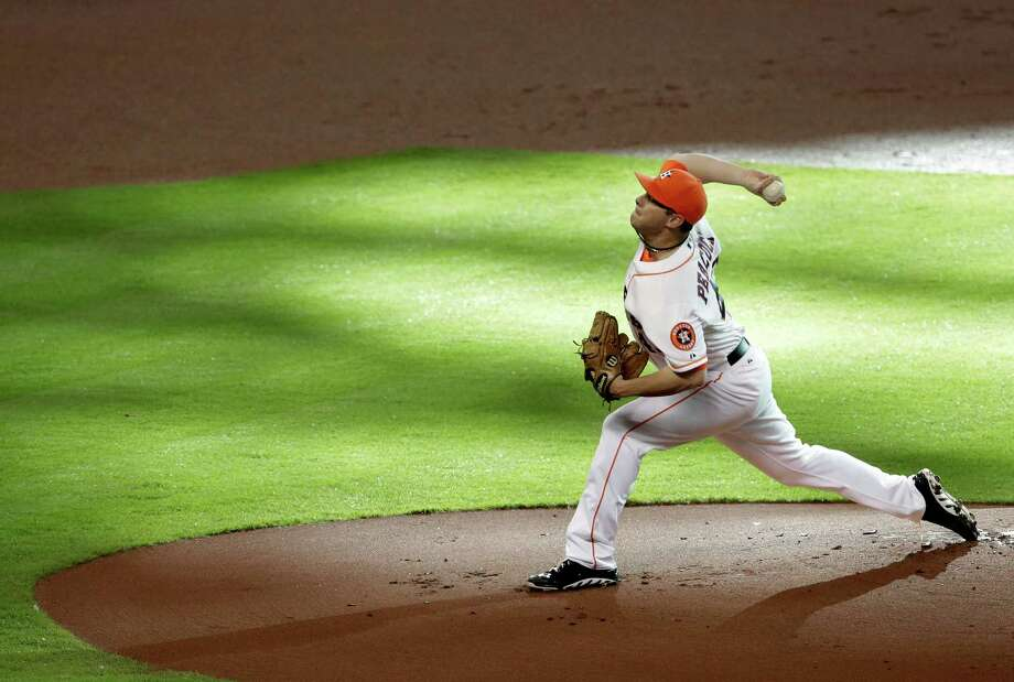 Houston Astros' Brad Peacock delivers a pitch against the Texas Rangers in the first inning of a baseball game, Saturday, Aug. 10, 2013, in Houston. (AP Photo/Pat Sullivan) Photo: Pat Sullivan, Associated Press / AP