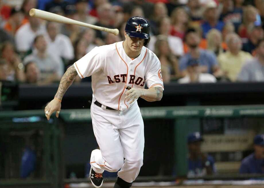 Houston Astros' Brandon Barnes tosses his bat after flying out to right field to end the second inning of a baseball game against the Texas Rangers Saturday, Aug. 10, 2013, in Houston. (AP Photo/Pat Sullivan) Photo: Pat Sullivan, Associated Press / AP