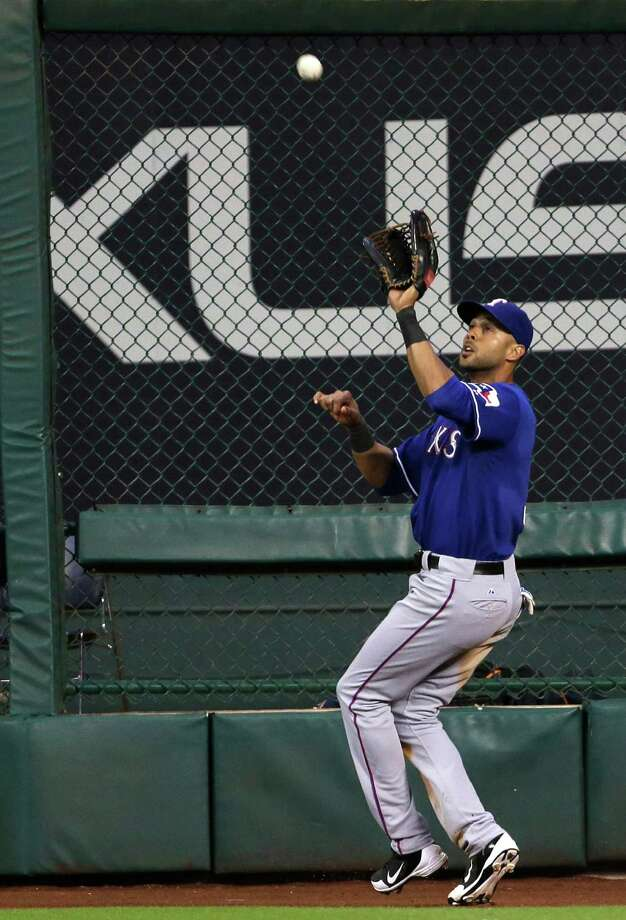 Texas Rangers' Alex Rios makes the catch for the final out of the baseball game against the Houston Astros, Saturday, Aug. 10, 2013, in Houston. The Rangers won 5-4. (AP Photo/Pat Sullivan) Photo: Pat Sullivan, Associated Press / AP