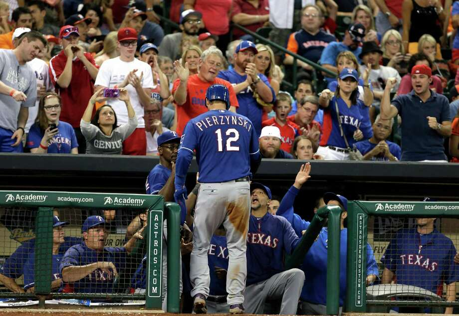 Texas Rangers' A.J. Pierzynski is welcomed back to the dugout after hitting a solo home run against the Houston Astros in the sixth inning of a baseball game, Saturday, Aug. 10, 2013, in Houston. (AP Photo/Pat Sullivan) Photo: Pat Sullivan, Associated Press / AP