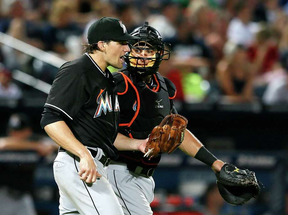Marlins pitcher Nate Eovaldi consults with catcher Jeff Mathis in the fifth inning against the Braves. Photo: Kevin C. Cox / Getty Images
