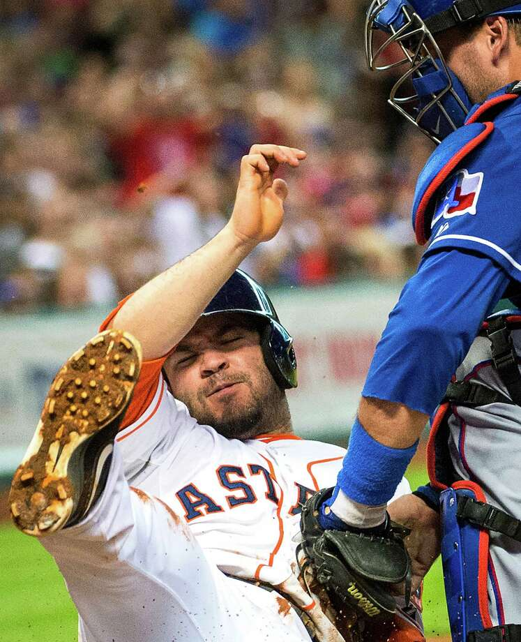 Houston Astros' Jose Altuve, left, is out at home as Texas Rangers catcher A.J. Pierzynski applies tag during the third inning of a baseball game at Minute Maid Park on Saturday, Aug. 10, 2013, in Houston. Altuve was thrown out trying to score on a single by catcher Jason Castro. Photo: Smiley N. Pool, Houston Chronicle / Houston Chronicle