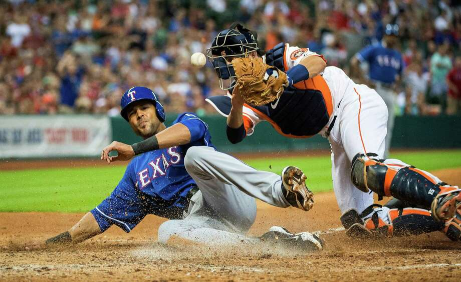 Texas Rangers' Alex Rios scores as the ball gets away from Houston Astros catcher Jason Castro during the eighth inning of a baseball game at Minute Maid Park on Saturday, Aug. 10, 2013, in Houston. The Rangers won 5-4. Photo: Smiley N. Pool, Houston Chronicle / Houston Chronicle