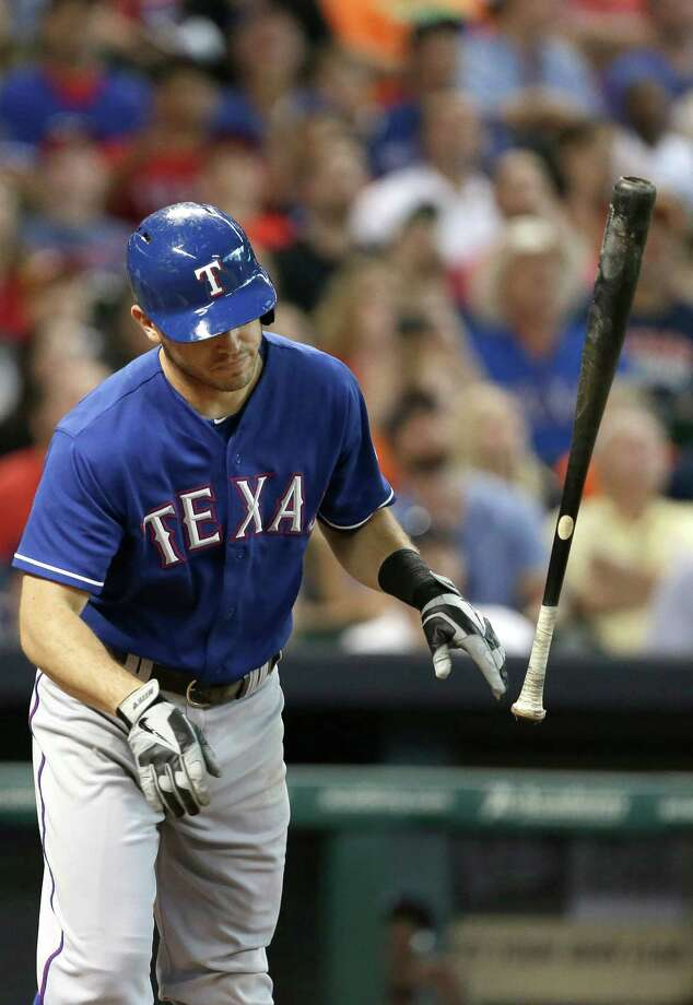 Texas Rangers' Ian Kinsler tosses his bat after popping out to first base against the Houston Astros in the third inning of a baseball game Saturday, Aug. 10, 2013, in Houston. (AP Photo/Pat Sullivan) Photo: Pat Sullivan, Associated Press / AP