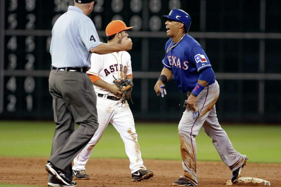 Texas Rangers' Leonys Martin, right, reacts as second base umpire Ron Kulpa, left, calls him out on an attempted steal as Houston Astros second baseman Jose Altuve looks away in the sixth inning of a baseball game, Saturday, Aug. 10, 2013, in Houston. (AP Photo/Pat Sullivan) Photo: Pat Sullivan, Associated Press / AP