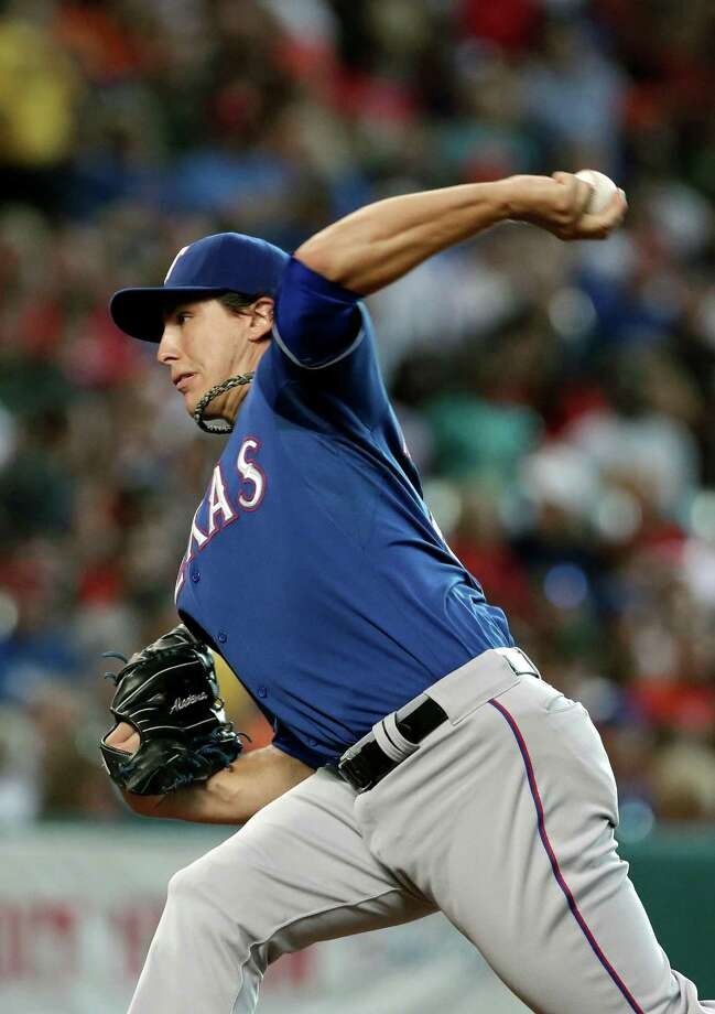 Texas Rangers' Derek Holland delivers a pitch against the Houston Astros in the second inning of a baseball game, Saturday, Aug. 10, 2013, in Houston. (AP Photo/Pat Sullivan) Photo: Pat Sullivan, Associated Press / AP