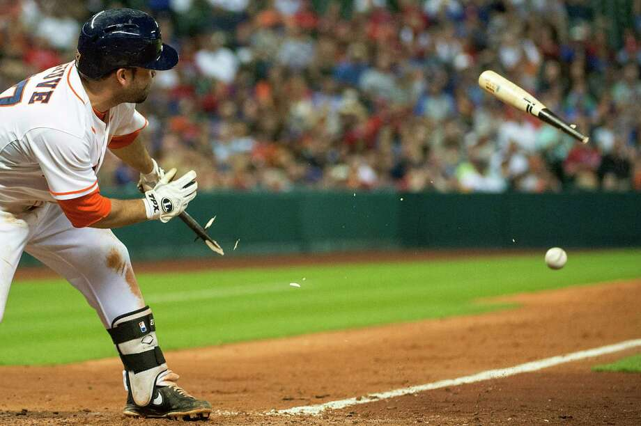 Houston Astros' Jose Altuve breaks his bat as he fouls off a pitch during the seventh inning of a baseball game against the Texas Rangers at Minute Maid Park on Saturday, Aug. 10, 2013, in Houston. Photo: Smiley N. Pool, Houston Chronicle / Houston Chronicle