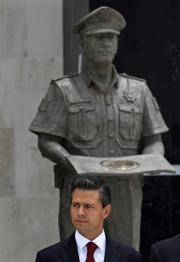 Mexico's President Enrique Pena Nieto attends a ceremony marking the anniversary of the federal police at the federal police intelligence center in Mexico City, Friday, July 12, 2013. Photo: Marco Ugarte, Associated Press