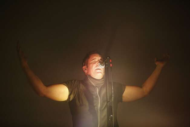 Trent Reznor of Nine Inch Nails Trent Reznor sings at the Outside Lands music festival. Photo: Ian C. Bates, The Chronicle