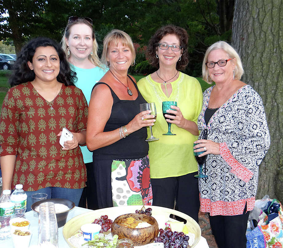 Levitt Pavilion marketing and communications director Carleigh Welsh, second from left, with Yamini Lal of Weston, Ellen Bowen and Ana Rogers of Westport, and Judy Kelhoffer of Trumbull at the DK Rekha concert Saturday on Jesup Green. Photo: Mike Lauterborn / Westport News contributed