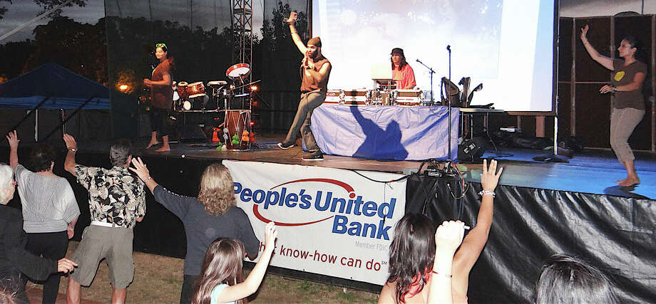 Choreographer Gobind Singh, center stage, leads audience in Bhangra dancing during the DJ Rekha show on Jesup Green. Photo: Mike Lauterborn / Westport News contributed