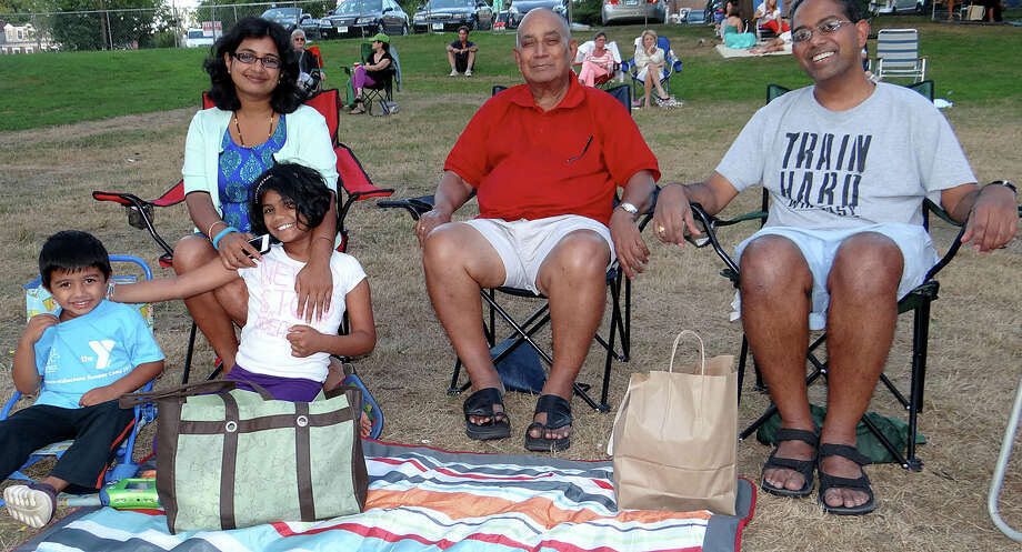 The Subramaniam family of Westport -- Maadhav, 3; Rama; Mallika, 7; Sivaram and Sridhar -- gathered Saturday evening for the Levitt Pavilion's presentation of DJ Rekha on Jesup Green. Photo: Mike Lauterborn / Westport News contributed