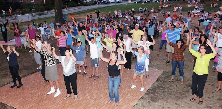The crowd is on its feet Saturday night at the DJ Rehka concert on Jesup Green. Photo: Mike Lauterborn / Westport News contributed