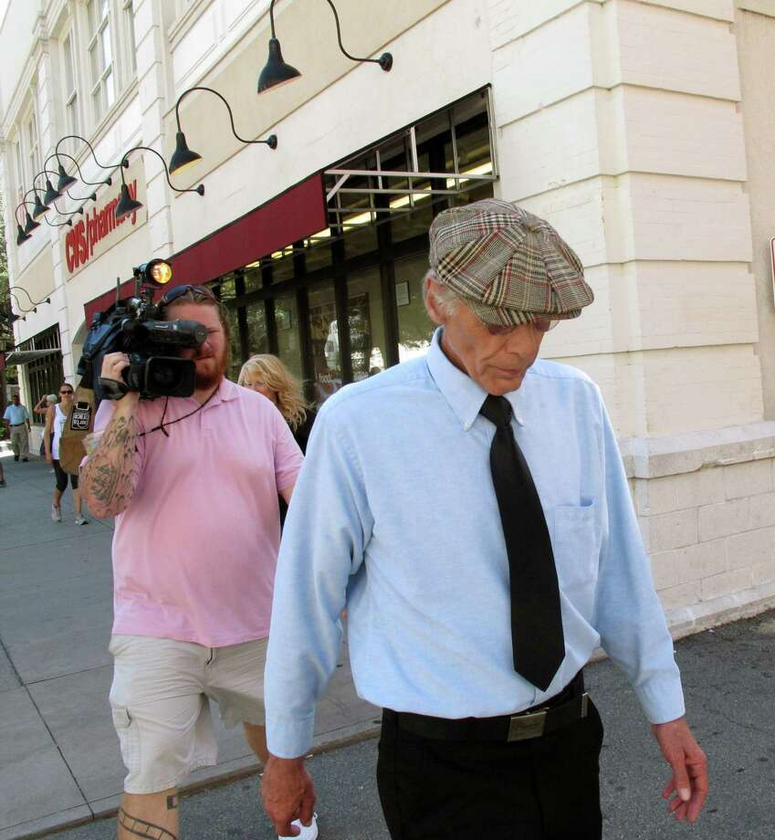 Thomas George Paculis walks past reporters after pleading guilty in federal court to attempting to extort $200,000 from celebrity cook Paula Deen, Friday, Aug. 9, 2013 in Savannah, Ga. Paculis, a New York man pleaded guilty in federal court Friday to trying to extort $200,000 from Paula Deen by threatening to reveal damaging information about the embattled celebrity cook if she didn't pay him to stay quiet. Photo: AP