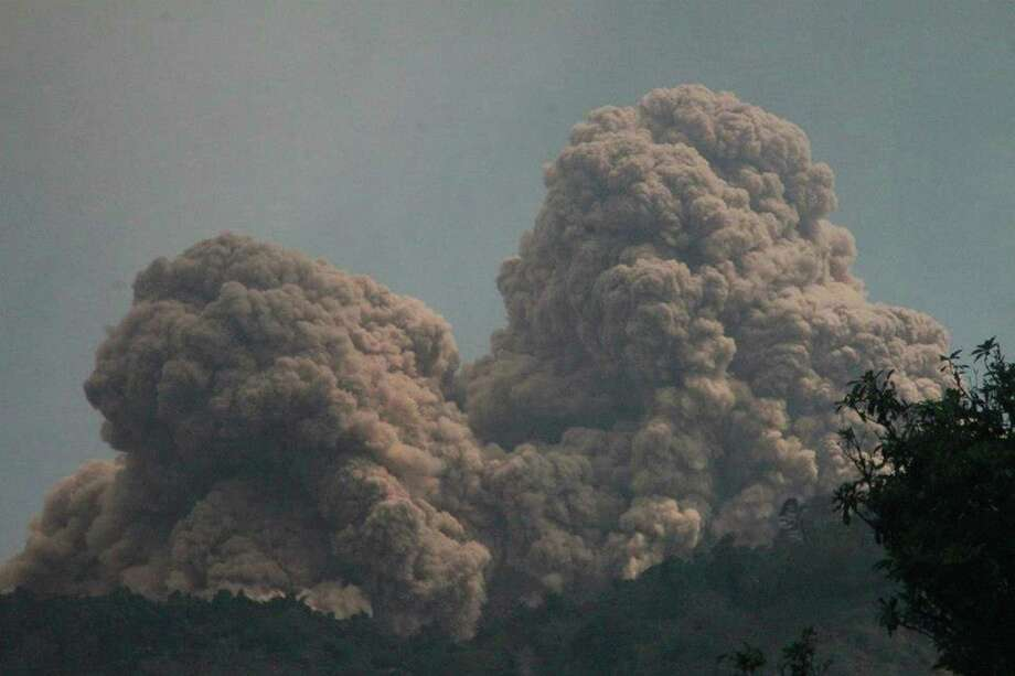 Mount Rokatenda spews volcanic material as it erupts on Palue island, Indonesia, Sunday, Aug. 11, 2013. Nearly 3,000 people have been evacuated from the island, according to the National Disaster Mitigation Agency. The volcano has been rumbling since last October. Photo: AP