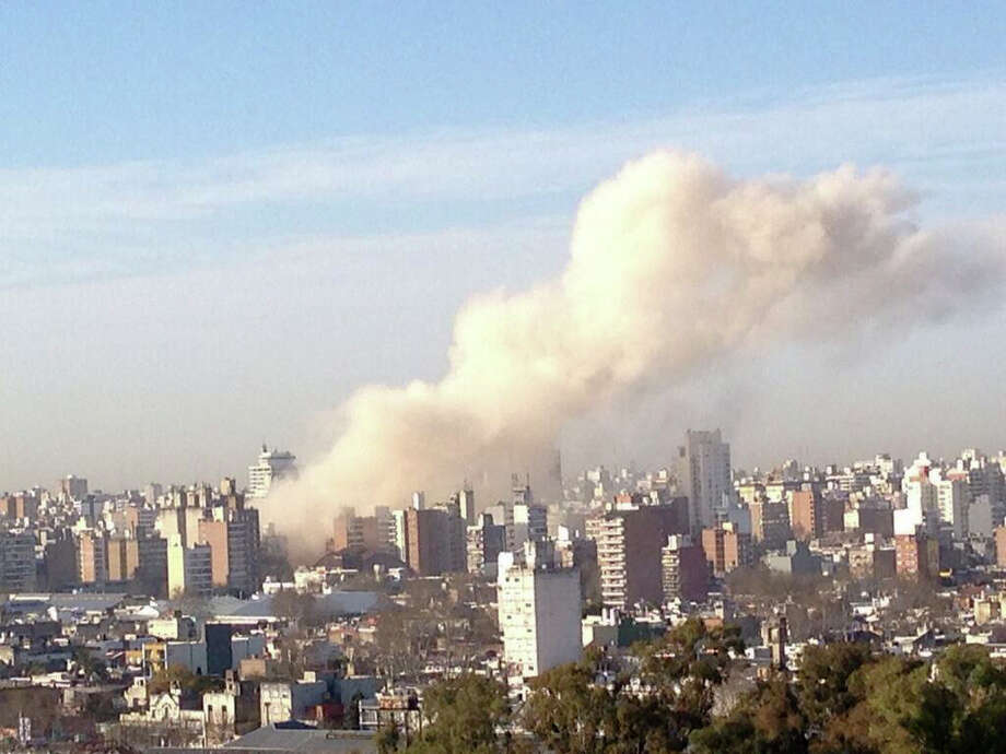 Smoke rises after a strong explosion shook a building, damaging three nearby buildings in Rosario, Argentina, Tuesday morning, Aug. 6, 2013. Preliminary reports said the explosion was registered at the building's central heating system and was probably caused by a gas leak. Local media reported people were trapped inside the building although no casualties were confirmed. Photo: AP