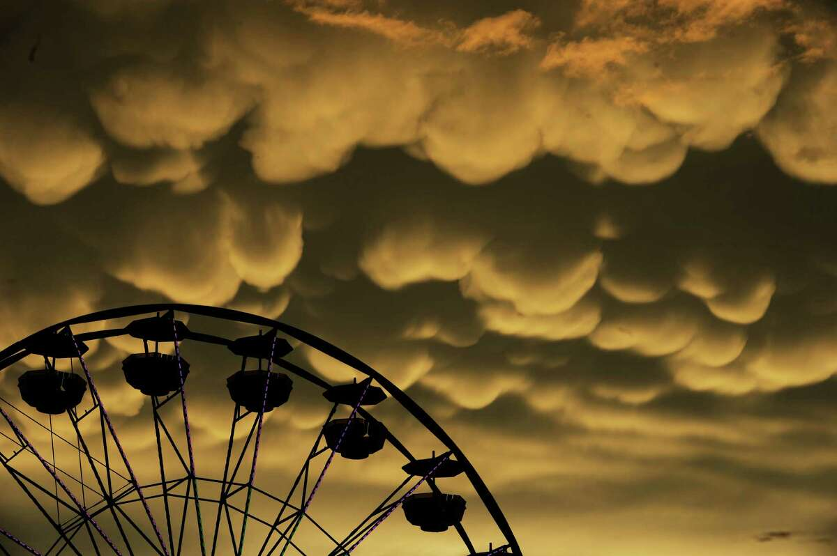 Mammatus clouds move over the Fredericksburg Agricultural Fair after a round of thunderstorms passed through the area on Thursday, Aug. 1, 2013.