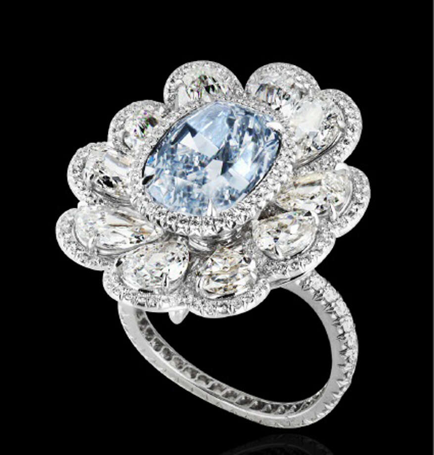 "In this undated image made available from Lloyds of London Tuesday Aug. 6, 2013, showing a jeweled ring, part of a $136 million (102 million euro) jewel theft. An affiliate of Lloyds of London announced Tuesday Aug. 6, 2013, a 1 million euro (US 1.3 million dlrs) reward for information leading to a diamond collection stolen at gunpoint from a jewel display in Cannes on July 28, 2013. The jewels belonging to the Israeli billionaire Lev Leviev were on display at the same hotel featured in Alfred Hitchcock's ""To Catch a Thief"" when a single gunman walked in to the ground floor show, threatened the handful of unarmed guards, and then disappeared down a side street with the $136 million cache, police have said. Photo: AP"