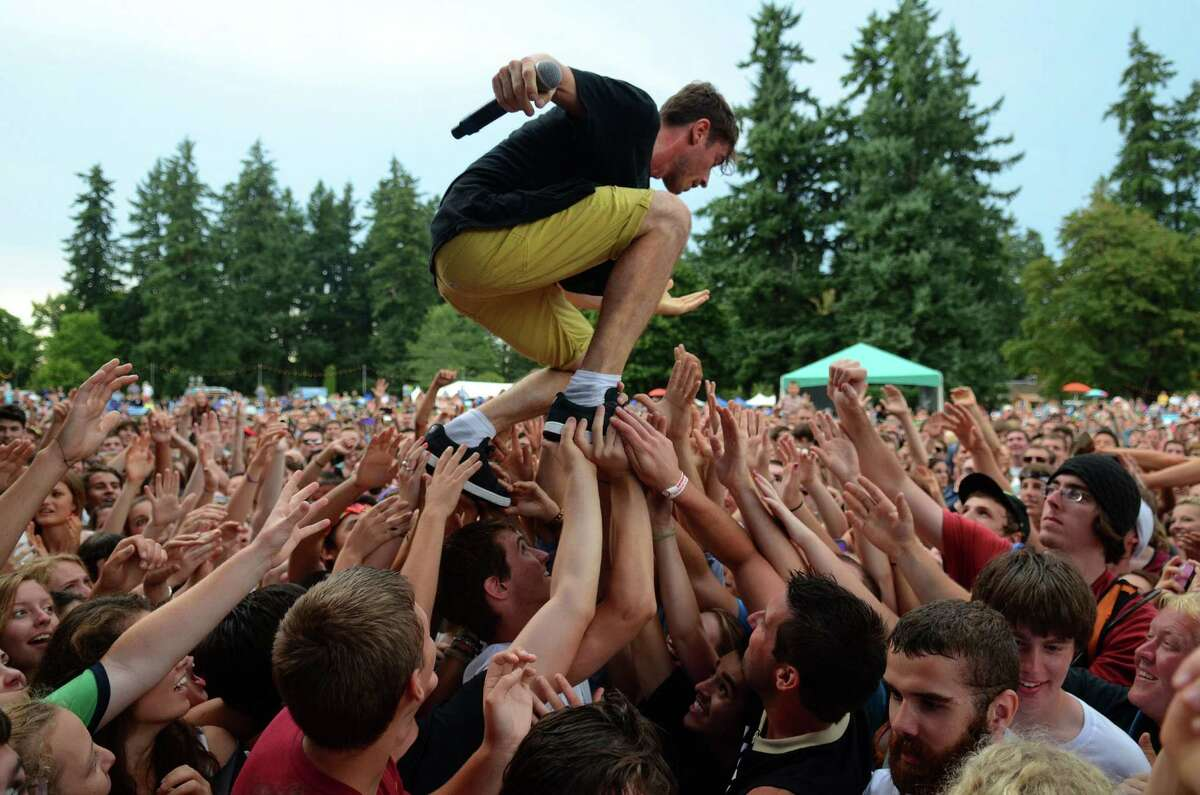 David Boyd of the New Politics walks across the crowd during their performance at the 107.7 The End Summer Camp concert Saturday, Aug. 10, 2013, at Marymoor Park in Redmond.
