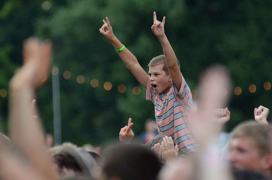 A young fan cheers on the New Politics during their performance at 107.7 The End's Summer Camp Saturday, Aug. 10, 2013, at Marymoor Park in Redmond. Photo: SY BEAN, SEATTLEPI.COM / SEATTLEPI.COM