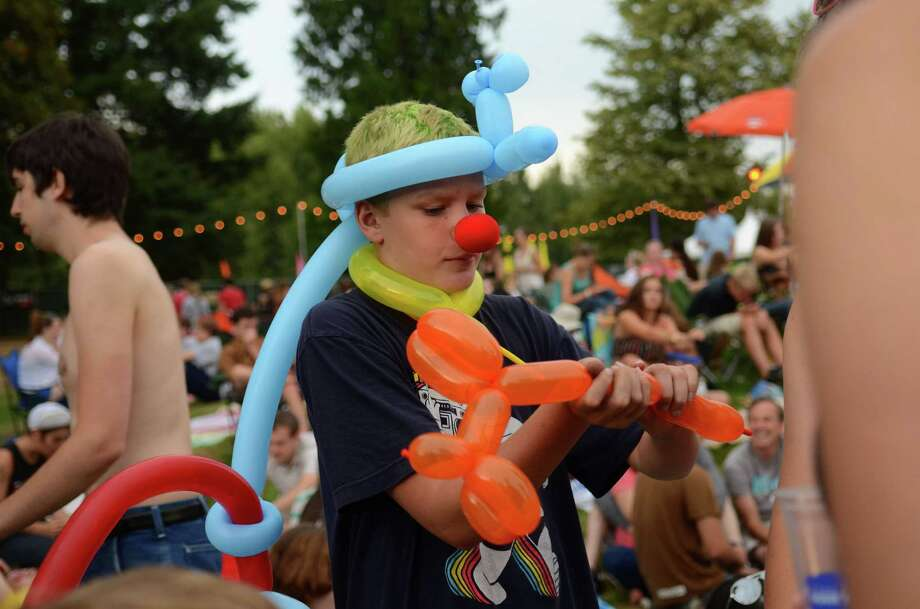 "Kane Kennedy, 12, also referred to as ""Flerb the Fantastic"" ties balloons for attendees of the 2013 107.7 The End's Summer Camp Saturday, Aug. 10, 2013, at Marymoor Park in Redmond. Photo: SY BEAN, SEATTLEPI.COM / SEATTLEPI.COM"