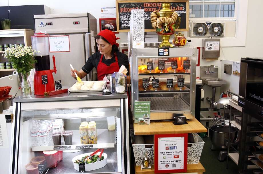 Anna Tvelova  makes piroshkis at her shop, Anda Piroshki, in San Francisco, Calif., Thursday, August 8, 2013.  Tvelova used a loan from Kiva to get going, and is now using another Kiva loan to open up a second location. Photo: Sarah Rice, Special To The Chronicle