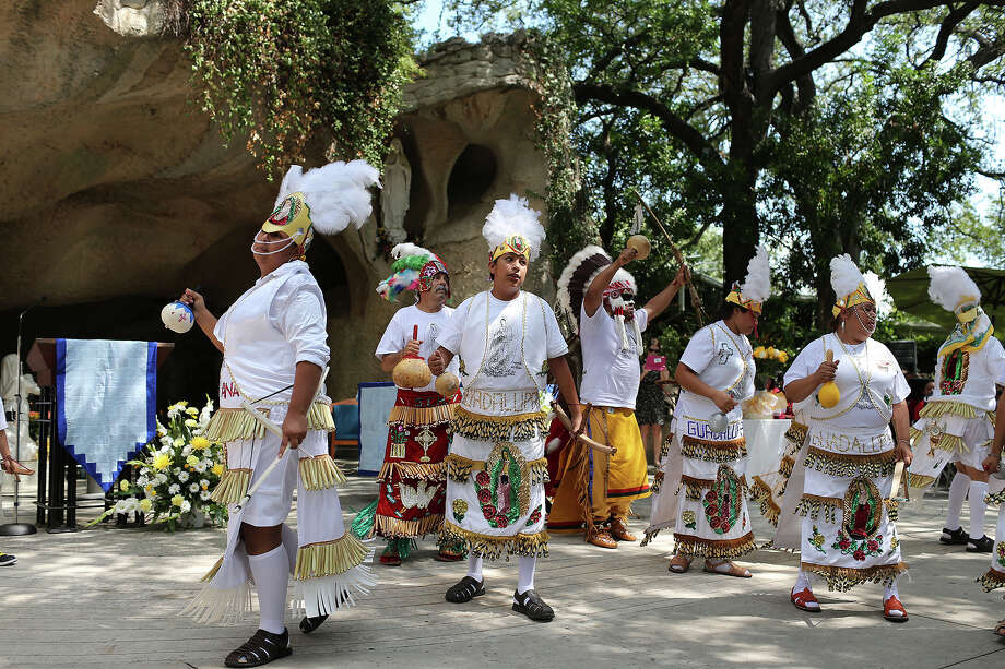 Members of Danza Gruta de Lourdes Tepeyac de San Antonio perform before Father Saturnino Lajo celebrates his 50th Ordination Anniversary with a Mass at Our Lady of Lourdes Grotto. Photo: Jerry Lara, San Antonio Express-News / San Antonio Express-News