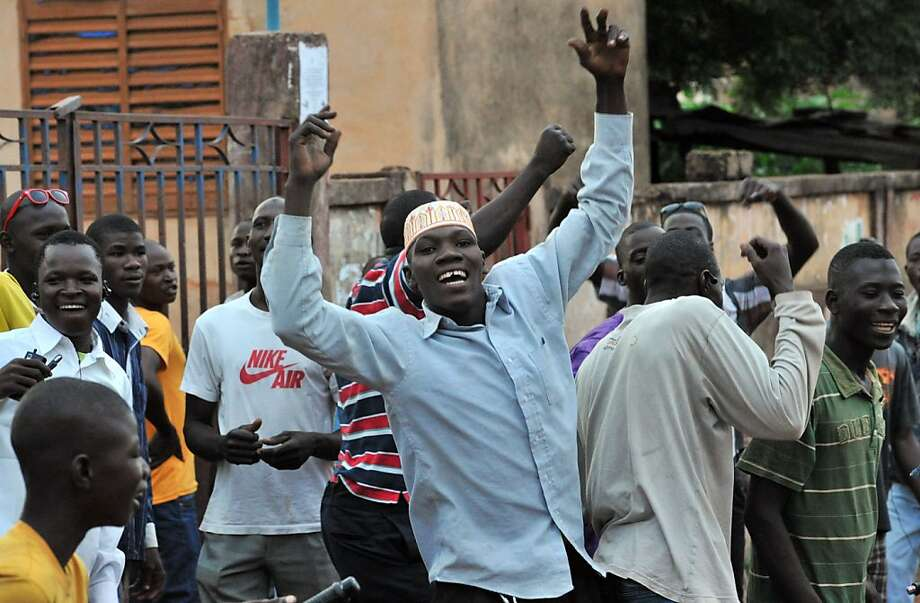 Supporters of Mali presidential candidate Ibrahim Boubacar Keita celebrate outside a polling station in Bamako as Malian electoral agents count the votes. Photo: Issouf Sanogo, AFP/Getty Images