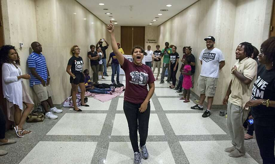 Annie Thomas leads a group of the Dream Defenders in the hallway outside Gov. Rick Scott's office in Tallahassee, Fla. The group demands changes to Florida's self-defense laws. Photo: Mark Wallheiser, New York Times