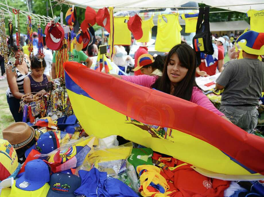 Shirley Quito, of New York, displays an Ecuadorian flag at the Ecuadorian Festival at Ives Concert Park in Danbury, Conn. on Sunday, Aug. 11, 2013.  The day-long festival attracted hundreds of people, who enjoyed food, games and music while celebrating the culture of Ecuador. Photo: Tyler Sizemore / The News-Times
